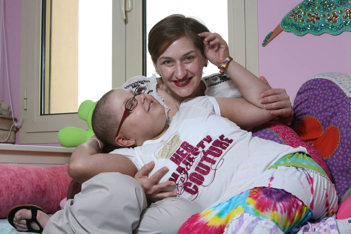 11-year-old Dania Alami pictured with her mother Dana Askari, in Dubai on May 7, 2009. Dania was last year diagnosed with a form of cancer called rhabdomyosarcoma and has been undergoing chemo and radiation therapy in New York, USA, for the past year.