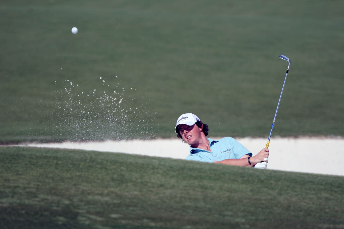Rory McIlroy from Northern Ireland takes a shot from the bunker on the first day of the Dubai World Championship golf tournament held on the Earth Course at the Jumeirah Golf Estates in Dubai on November 19, 2009.
