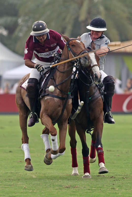 Action between Qatar and Emirates NBD during the 4th Cartier Dubai Polo Challenge held at the Desert Palm Polo Ground in Dubai on March 27, 2009.