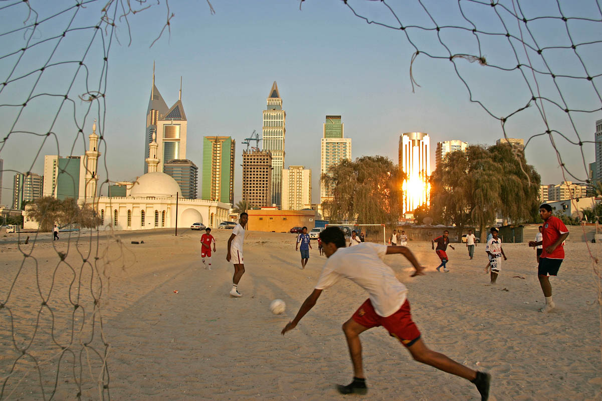 Local boys play soccer together in Dubai on May 30, 2006.