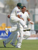 Pakistan's Tanveer Ahmed, right, celebrates with teammate Abdur Rehman, left, after taking the wicket of South Africa's captain Graeme Smith on the first day of their second cricket test match in Abu Dhabi on Saturday, Nov. 20, 2010.  (AP Photo/Randi Sokoloff)