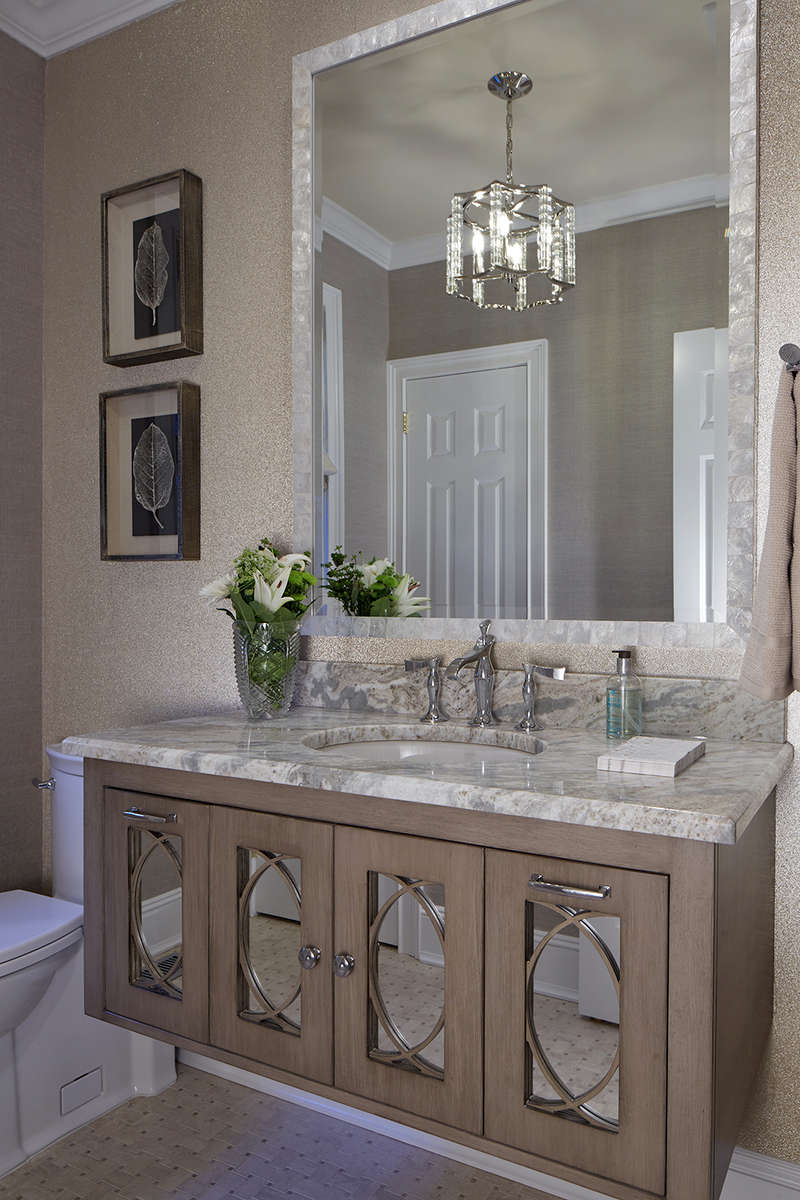 Belle Terre powder room renovation with glass bead wallcovering and wall mounted mirrored vanity