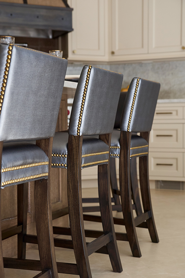 Custom counter stool upholstery with navy vinyl and nail heads