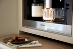 Built-in Miele with custom pull out shelf