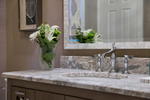 Belle Terre powder room renovation with wall mounted vanity and quartzite counter top