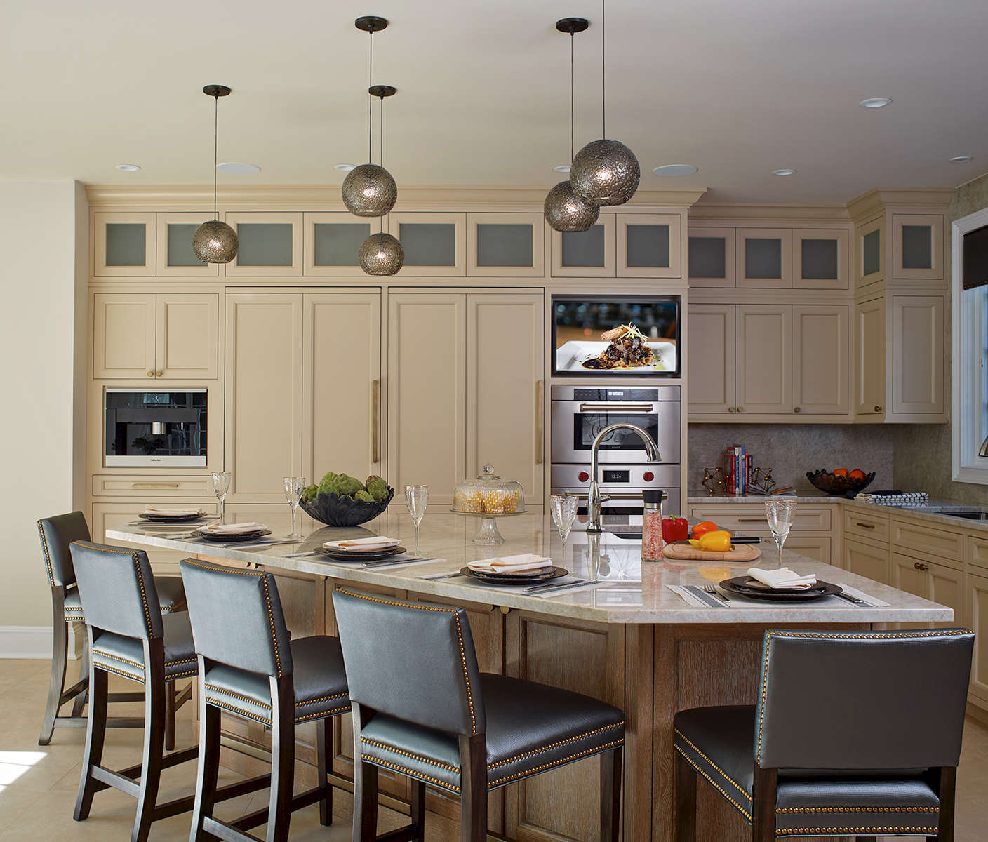 Two tone kitchen with taupe painted finish on the perimeter and a cerused wood finish on the island