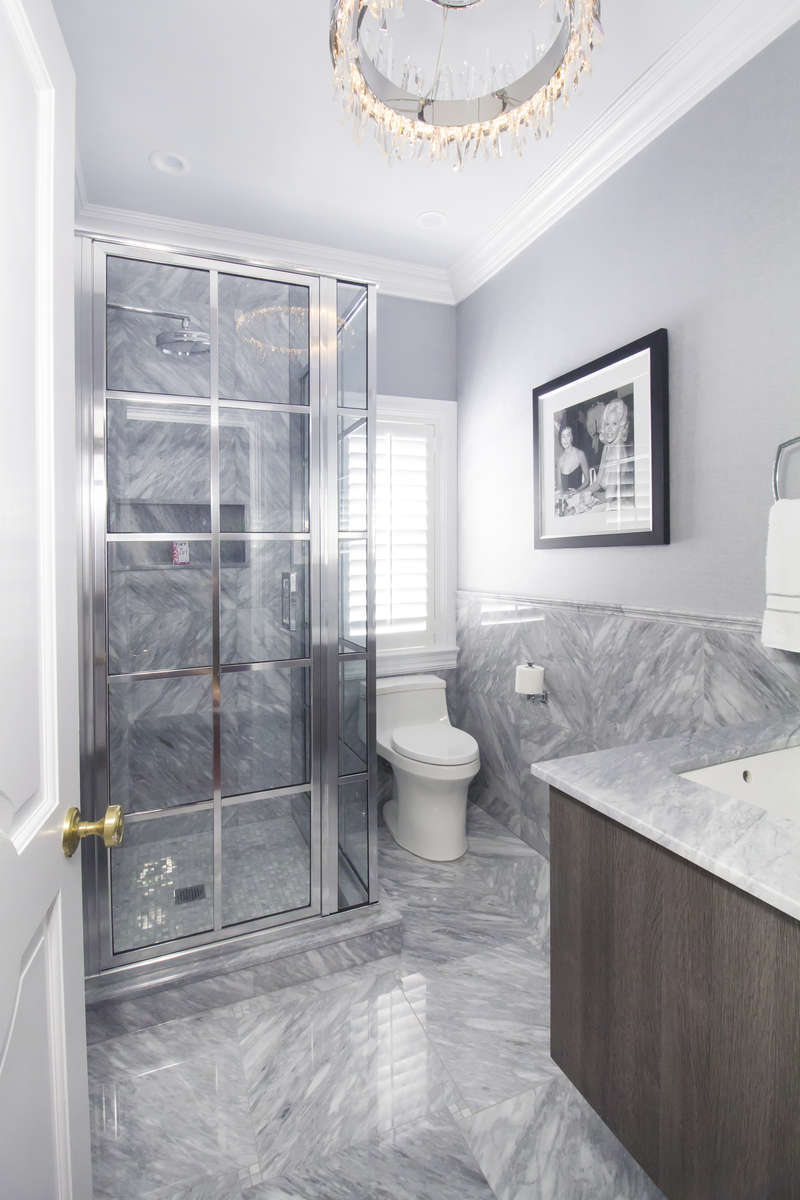 marble bathroom with coastal shower door shower enclosure