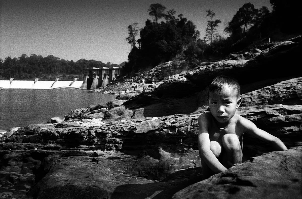 A boy in front of the Theun Hinboun dam.