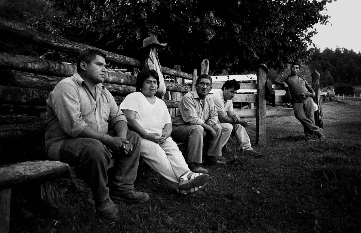 Daniel Queupumil Fucha (left) and Nori Quintoman Trafipan (n.2 from the left) together with some of their fellow dam opposers. Daniel and Nori are among the main activists from the Mapuche community in Liquine fighting against the dam projects. Since the beginning of the battle theyhave become experts in all legal matters regarding indigenous populations and natural resources, with help from the Chilean human rights organization {quote}Observatorio Ciudadano{quote}.