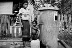 Villagers using a waterpump offered by a european NGO.
