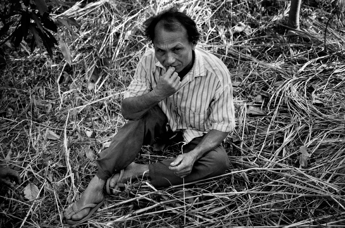 Mr. K. C. in the fruit garden that he and the villagers got as sole compensation for the loss of rice-fields and fishing opportunities. Apart from being far away from the village on the other side of the river, the fruit garden has not proved productive and is now more or less abandoned.