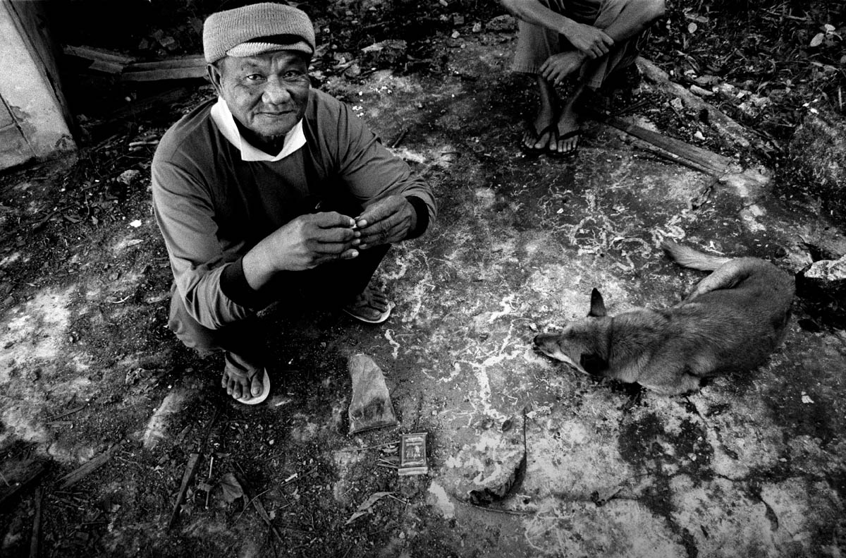 Mr. Kan Wangphon (73). For the loss of his house, situated on the present dam site, he got a new house a few kilometres away from the river that was never constructed completely. The distance from the river makes it impossible to cultivate rice and vegetables and to continue fishing.