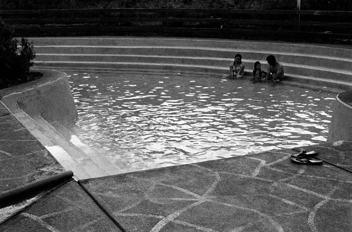 A family relaxing in one of the termal baths in Liquine. The hydroelectric project includes a series of underground tunnels and the local tourist entrepreneurs are worried that the natural hot springs will be damaged as a consequence of the tunnels. Such a situation could create a negative domino effect on the whole economy in the area.