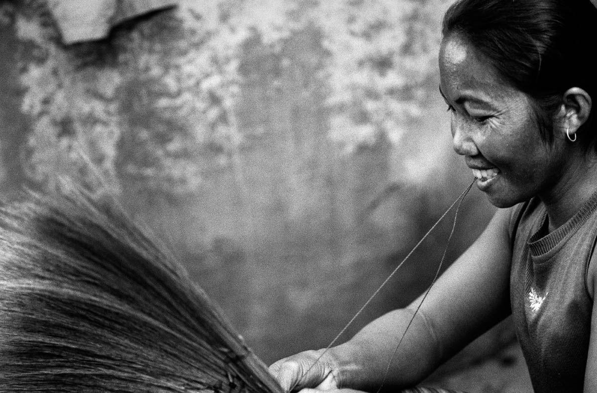 One of many women who have converted to hand-crafts to earn money for the family because they cannot go fishing anymore in the river.