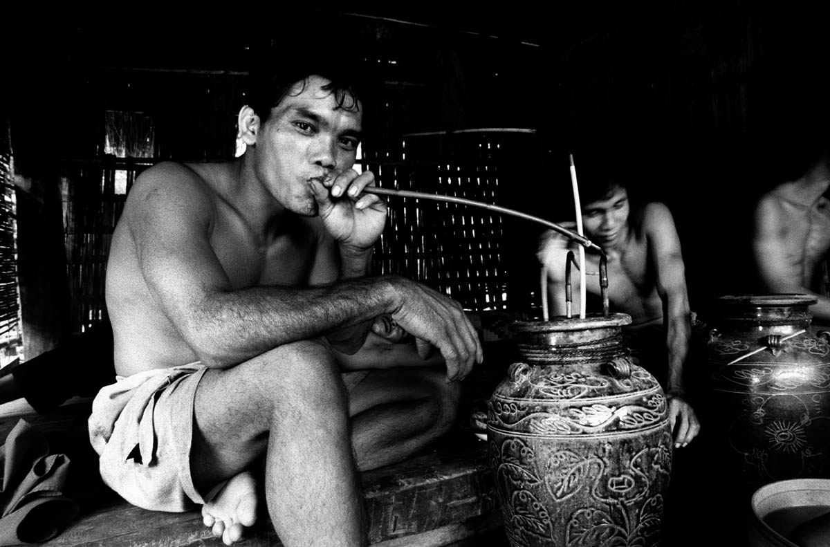 After the disappearance of fish in the Se San river many young men are passing time drinking home-made rice-wine instead of fishing.