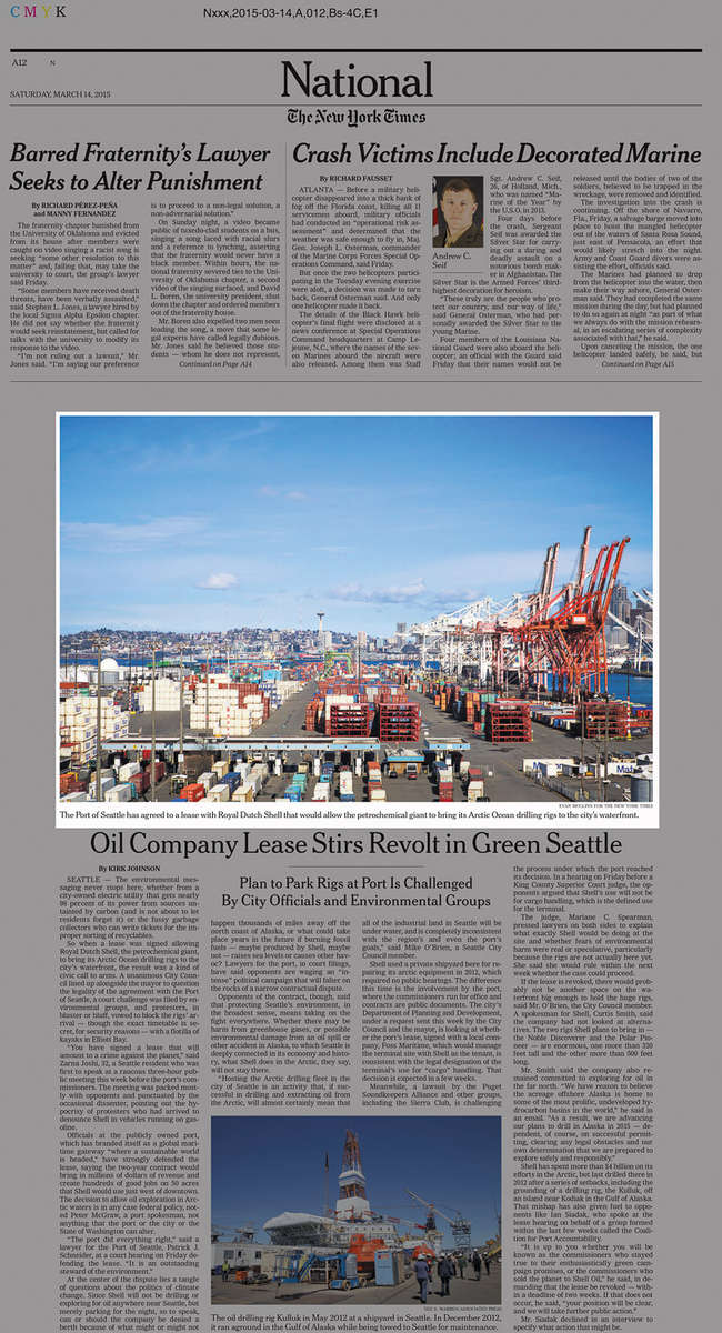 A high angle shot of the busy port in Seattle covered with cargo containers, cranes and massive shipping vessels. The photo was taken by Evan McGlinn for The New York Times