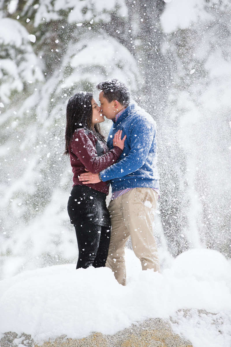 Tahoe-falling-snow-engagement-photo