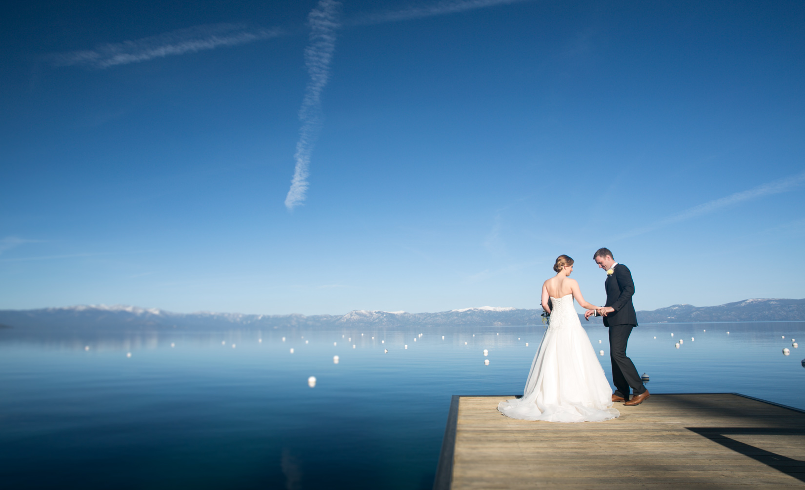 West Shore Cafe                                Jen and MilesLake Tahoe spring wedding on the West shore of Lake Tahoe with the ceremony on the pier and reception inside the beautifully ornate restaurant .