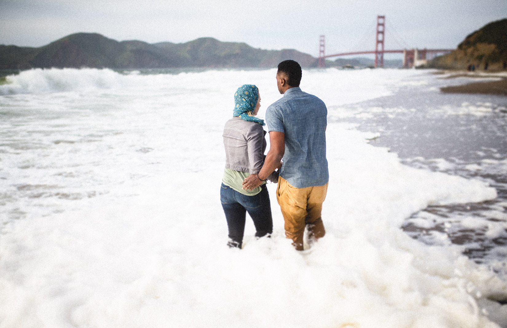 water-and-sand-engagement-photos
