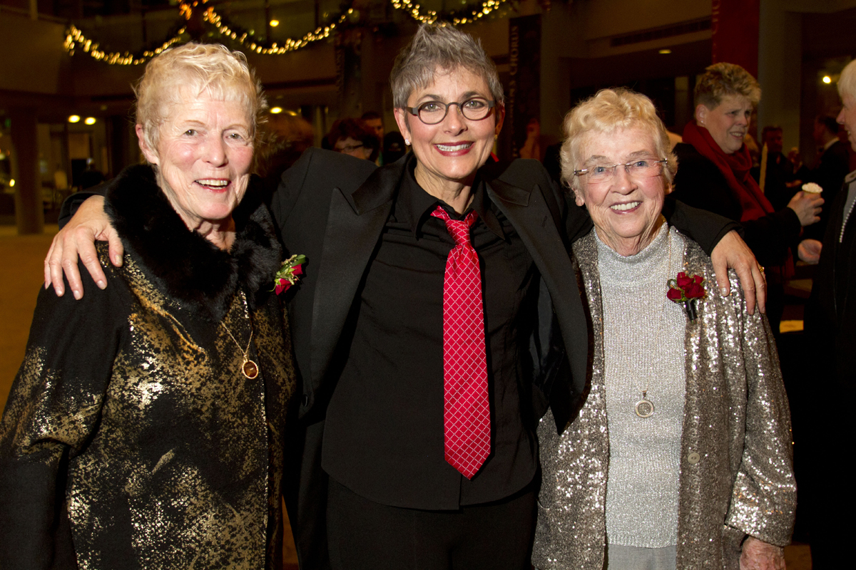 Jane Abbott Lighty, left, and Pete-e Petersen, (right) from Seattle, pose with a friend after their wedding at beneroya Hall in Seattle, Wash., on December 9, 2012. Lighty and Peterson, who have been romantic partners for 35 years received the first same-sex marriage license in Washington state after voter's approved to make it legal. {quote}I just can't believe this is happening after all these years.{quote} said Peterson. (© Karen Ducey 2012)