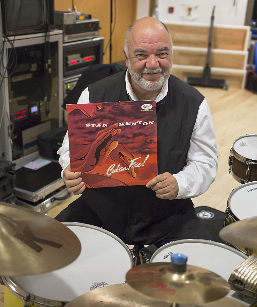 """Johnny Richards' writing has always struck me as being bold, exciting, brash, tender AND noble. 'Cuban Fire' is his masterpiece, and the Kenton orchestra of the 1950's with Mel Lewis propelling a stellar group of horn players and soloists and percussionists— including my teacher George Gaber who played timpani on 2 cuts — is the height of big band ecstasy for me. I've treasured this album ever since I was young, and listening to it still gives me goosebumps, inspiring me and reminding me of why I've always wanted to play the drums. Choosing 'Cuban Fire' as my One LP disc was an easy and natural choice.""Peter Erskine: Stage right, The Bridgewater Hall, Manchester, 20th November 2015Stan Kenton: Cuban Fire! released 1956Peter Erskine"