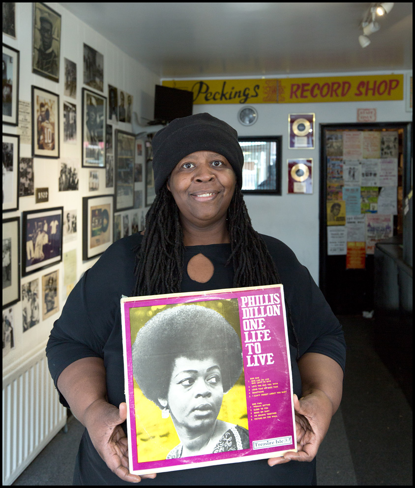 """""""I chose the album {quote}One Life To Live{quote} by Phyllis Dillon as the cover itself depicts a powerful image of her sporting an Afro. This for me marks a time of pride and political struggle, an era of Black Power where we were encouraged to embrace our natural hair as African diaspora people globally. The cover has her fully clothed unlike many other albums of this era which objectified women, showing them scantily clad in very sexualized poses.The album itself is very easy to relate to as it is one of love and heartbreak, two very common human experiences/emotions. The album is easy to listen to, and reminds me of my mum's friend Auntie Bev, who was also a DJ and would play some of these tunes and sing along over the microphone at her house parties. To some extent this LP reflects the softer and more romantic side of Sister Culcha - the sound woman who operated in that male dominated world.Produced by Duke Reid of Treasure Isle, this album has stood the test of time.""""Sister Culcha: Peckings Record Shop, Shepherd's Bush, London, 18th January 2019Sound operator and music historianPhyllis Dillon: """"One Life To Live"""" released 1972Peckings Record Shop"""