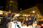 """He's all about making my dreams come true,{quote} Anita Emde says of her husband Mick Emde, both from Redmond, WA.  {quote}I've always wanted to be in a horse-drawn carriage."" The two enjoy a horse and carriage ride around the Westlake Center area in Seattle, WA on December 9, 2017. ""It was romantic. It was warm. He provided a nice blanket,"" she says. (© Karen Ducey)"