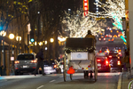 Steve Beckmann of Sealth Horse Carriages drives his horse and carriage down 5th Ave. in Seattle, WA on December 9, 2017. Beckmann says he was the first horse and carriage business in Seattle and now, 42 years later, he is the only one left. (© Karen Ducey)