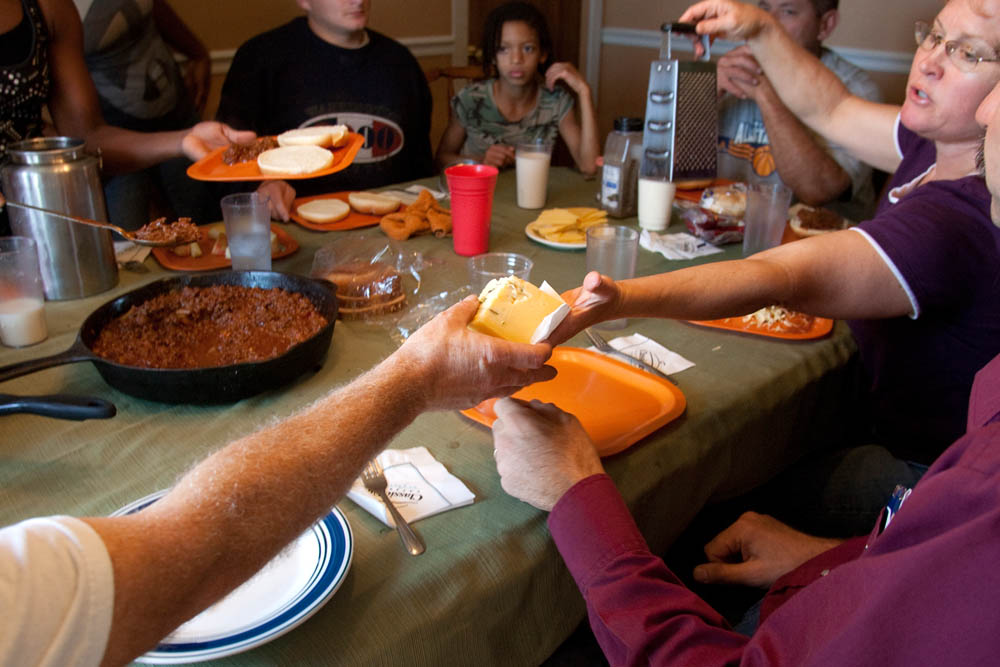 One of their specialty cheeses is passed around the table during lunchtime at the Estrella Family Creamery in Montesano,Wash. on November 4, 2010.  The Food and Drug Administration ordered the Estrella Family Creamery in Montesano,Wash.  to stop processing cheeses after it found listeria bacteria on some of the cheeses this year.  The family says they have made many renovations on the farm and the bacteria is only found on the soft cheese, not everything.  They believe they should be allowed to resume making cheese and sell the hard cheeses they have already made at the facility.  The creamery is one of Washington's most famous artisan cheesemakers.  (photo credit Karen Ducey)