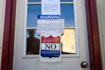 No trespassing signs were taped to the doors on all caves storing cheese at the Estrella Family Creamery in Montesano,Wash.  on November 4, 2010.  The Food and Drug Administration ordered the Estrella Family Creamery in Montesano,Wash.  to stop processing cheeses after it found listeria bacteria on some of the cheeses this year.  The family says they have made many renovations on the farm and the bacteria is only found on the soft cheese, not everything.  They believe they should be allowed to resume making cheese and sell the hard cheeses they have already made at the facility.  The creamery is one of Washington's most famous artisan cheesemakers.  (photo credit Karen Ducey)