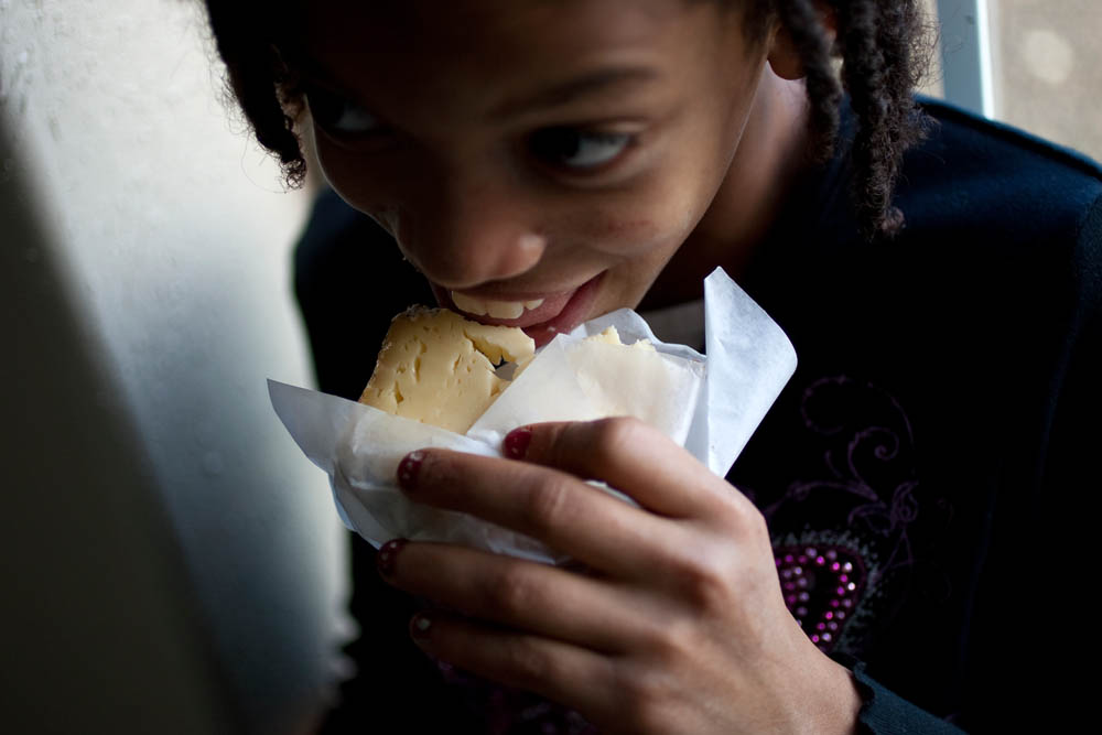 Faith Estrella, 11, takes a bite out of one the speciality cheeses at the Estrella Family Creamery in Montesano,Wash.  on November 4, 2010.  The Food and Drug Administration ordered the Estrella Family Creamery in Montesano,Wash.  to stop processing cheeses after it found listeria bacteria on some of the cheeses this year.  The family says they have made many renovations on the farm and the bacteria is only found on the soft cheese, not everything.  They believe they should be allowed to resume making cheese and sell the hard cheeses they have already made at the facility.  The creamery is one of Washington's most famous artisan cheesemakers.  (photo credit Karen Ducey)
