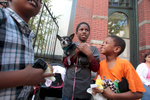 From left to right: Jazzari Watson, 7, Damari Thomas, 9,  and his brother Romel Moore,6, hold Cha Cha, a nine-year old dog they met on line as they wait outside the Doney Memorial Pet Clinic in Seattle, WA on June 25, 2016. They are with their grandmother, Donna Young, and her cat, Kitty, who has blood in her urine to see a veterinarian. The family is currently living in an apartment. (photo © Karen Ducey Photography)Homeless and low income people bring in their pets to see veterinarians and pick up food at the Doney Memorial Pet Clinic located in the Union Gospel Mission in Seattle, WA on June 25, 2016. (photo © Karen Ducey Photography)