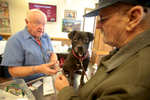 Danny Price (right) and his dog Pepper, 9 years, Homeless and low income people bring in their pets to see veterinarians and pick up food at the Doney Memorial Pet Clinic located in the Union Gospel Mission in Seattle, WA on June 25, 2016. (photo © Karen Ducey Photography)