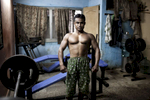 INDIA, MUMBAI 2014Iqbal training in the only gym present in Lallubhai compound.Mumbai \{quote}slum rehabilitation\{quote} project forced people to move to places like Lallubhai Compound in Mankhurd: 100 building central cluster rises ominously, each building separated from the other by a small corridor full of garbage,.Welcome to Mumbai\'s slum resettlement housing projects, the future of the big metropolis, Vertical Slums @Giuliodisturco