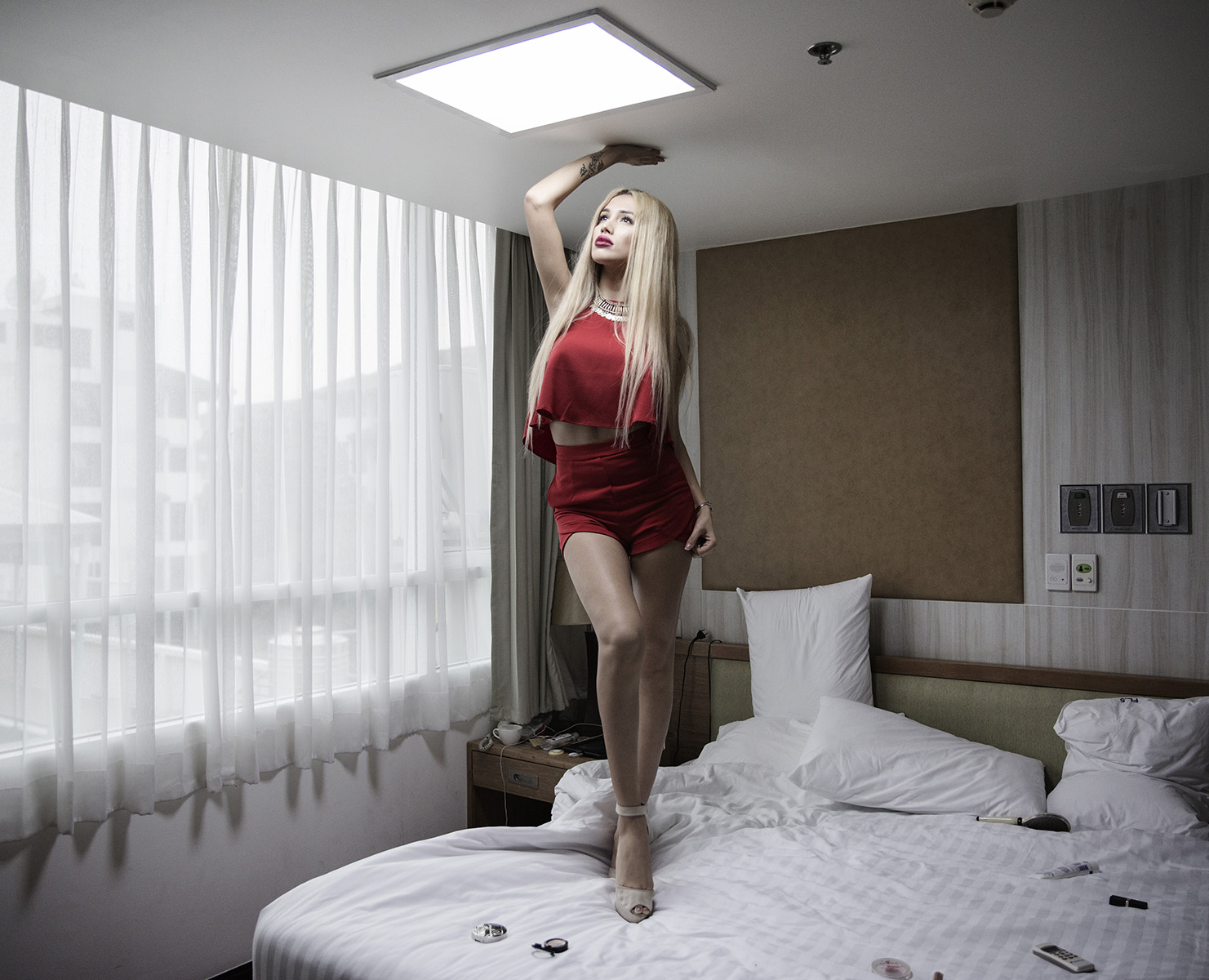 A russian patient in her room at Kamol Hospital on February 16th 2016 in Bangkok, Thailand. 22 year old Agnes Landau had her sex reassignment surgery at Kamol Hospital on January 20th. She comes from the muslim south of Moscow, Russia. Her mother is from the middle east and father from Russia. © Giulio Di Sturco