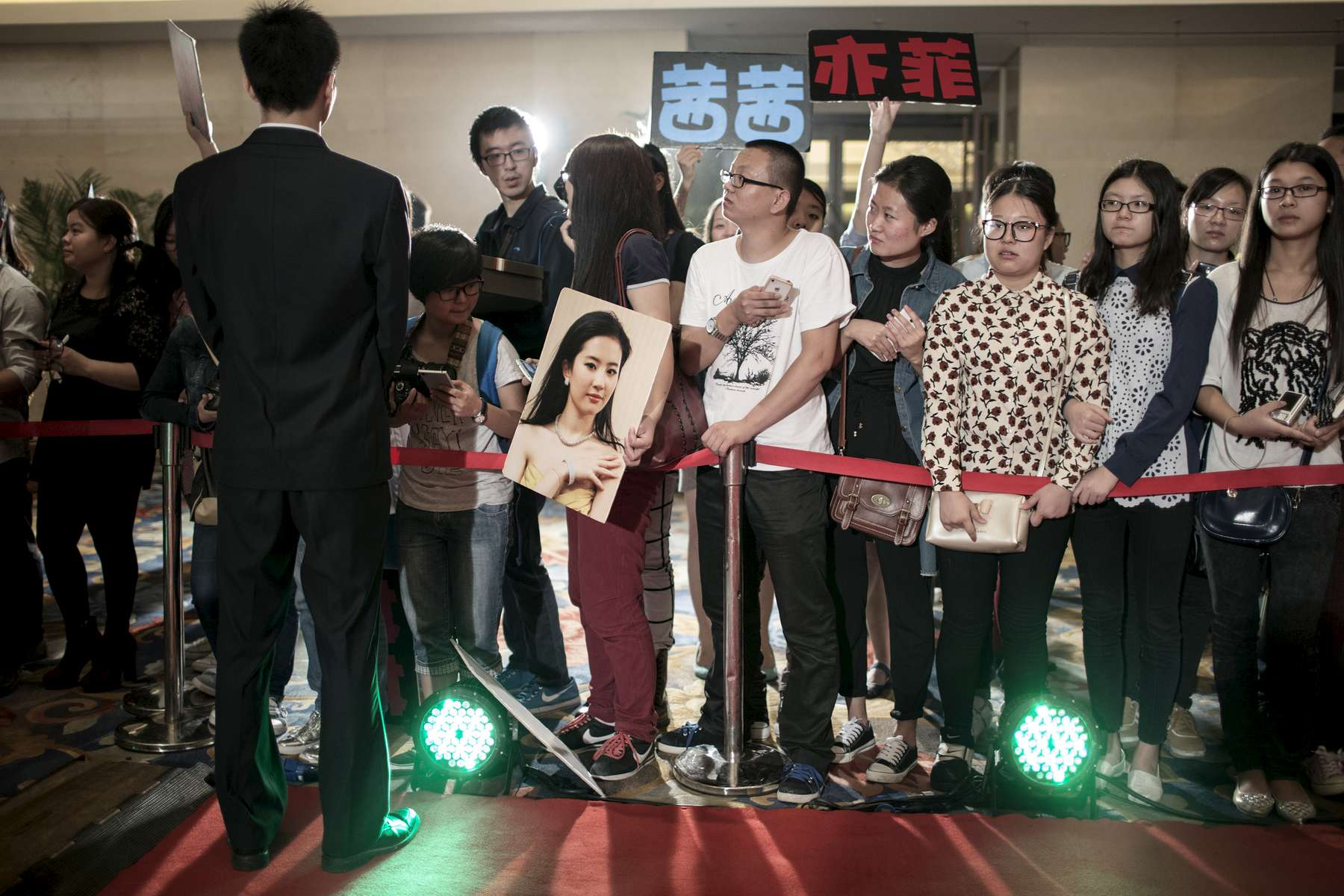 Younge fans on the red Carpet for the Premiere of a big US/China coproduction movie, \{quote}Outcast\{quote} feauturing Nicholas Cage, September 2014