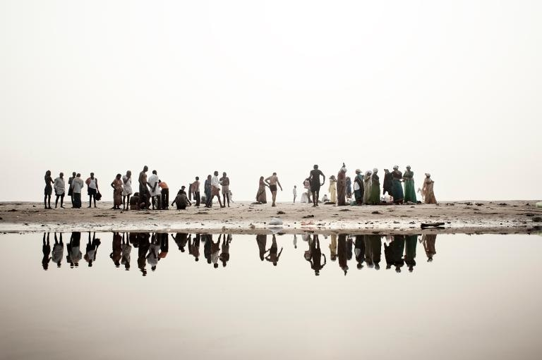 "Giulio Di Sturco's 'Ganges' in National GeographicThe World's Most Polluted River Revealed in PhotosA recent high court ruling in India that gives the Ganges personhood status may lead to environmental redemption.By Austa Somvichian-ClausenAn image of a woman walking on water might inspire awe under normal circumstances, but in this case it arouses something that feels more like horror.Photographer Giulio Di Sturco captured scenes like this one in his Death of a River series: a woman traversing the Ganges River, ambling along on a bridge of muddied sandbags and waste, to show the extent of degradation that has afflicted this holy body of water.""The Ganges is a prime example of the unresolved contradiction between man and the environment,"" says Di Sturco. It is a river intimately connected with every aspect of Indian life—a source of water, energy, and livelihood for more than 500 million people who live along its banks.Hindus around the world have worshipped the river for centuries, their beliefs stemming from the story of the self-cleaning river god Genga. The same cleansing properties cannot be said for the river itself, whose waters are poisoned by millions of gallons of industrial effluents and raw sewage every day. Not to mention the hundreds of bodies that are cremated, or sometimes simply wrapped in muslin, and tossed into the river daily.But things are changing for the ""Ganga Mata,"" or divine mother, after a recent high court ruling in India. The Uttarakhand High Court has declared the Ganges and its main tributary, the Yamuna, ""living persons.""The decision means that polluting or damaging the rivers could be considered the legal equivalent to harming a person. Although environmentalists welcomed the ruling, the question remains whether it will be enforced, and if so to what extent.read the rest of the article on nationalgeographic.com, check out the feature"