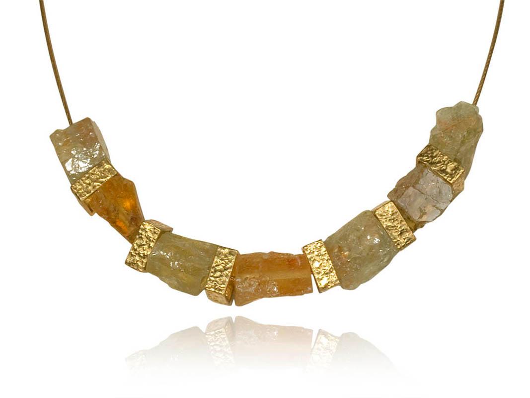 22 karat gold, beryl