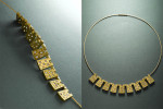 22 karat gold and diamonds on 18 karat twisted neckwire.