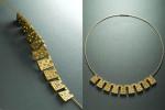 22 karat gold and diamonds on 18 karat twisted neckwire.