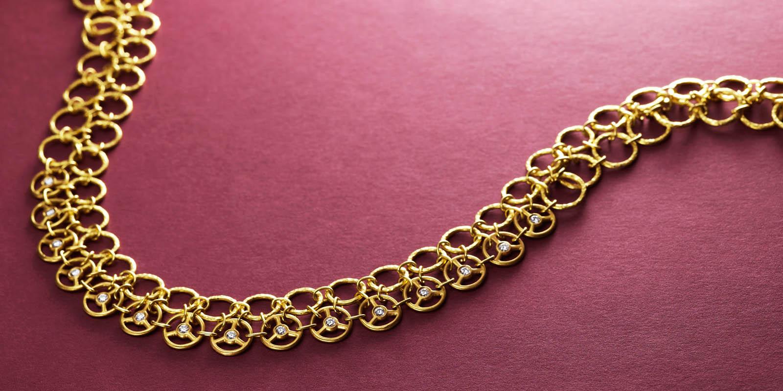 Samurai necklace with diamonds and 22 karat gold.