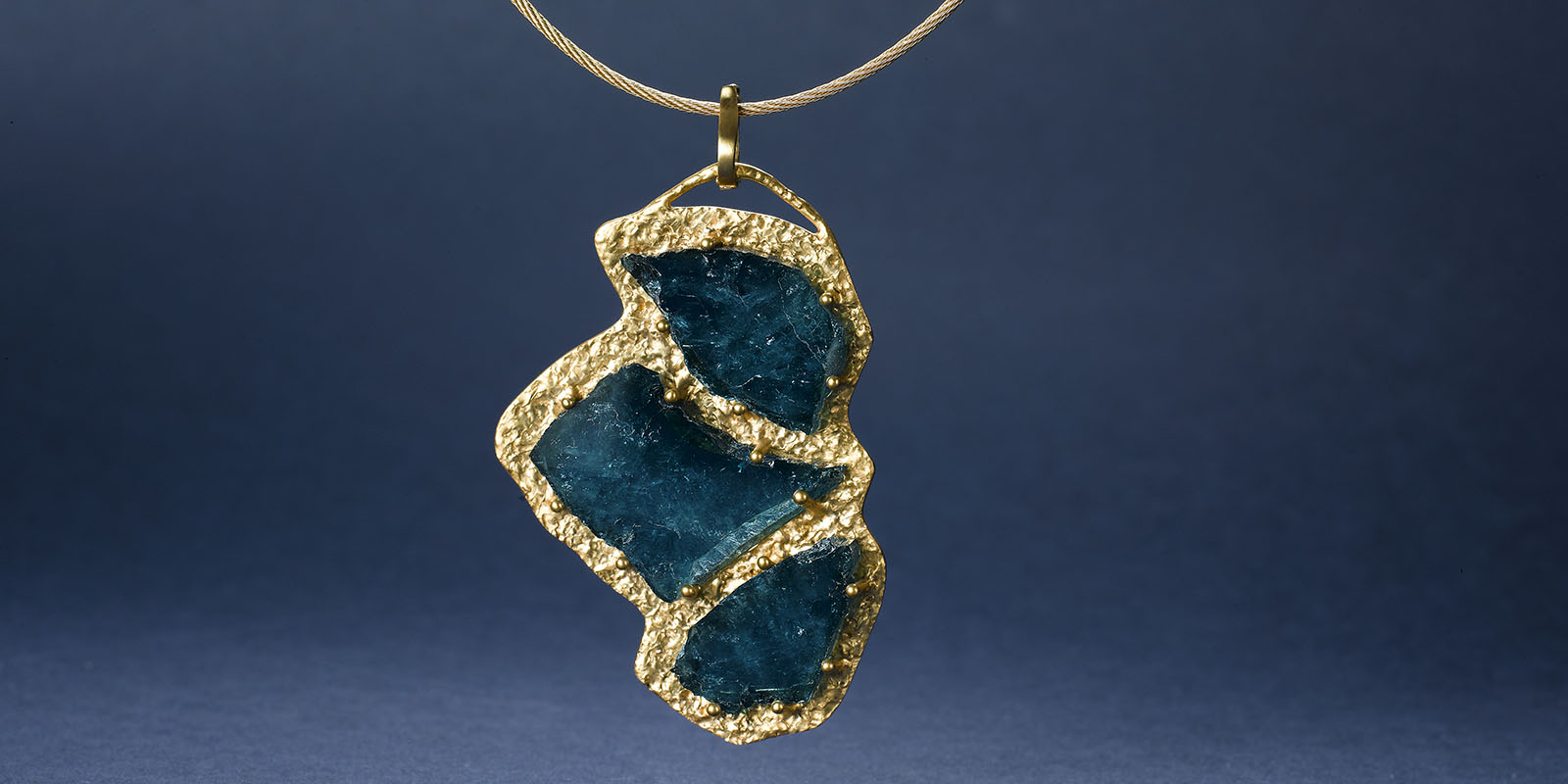 22 karat gold and blue tourmaline slice