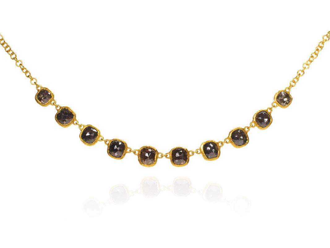 22 karat gold, opaque diamonds