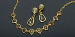Necklace and earrings with opaque diamonds in 22 karat gold.