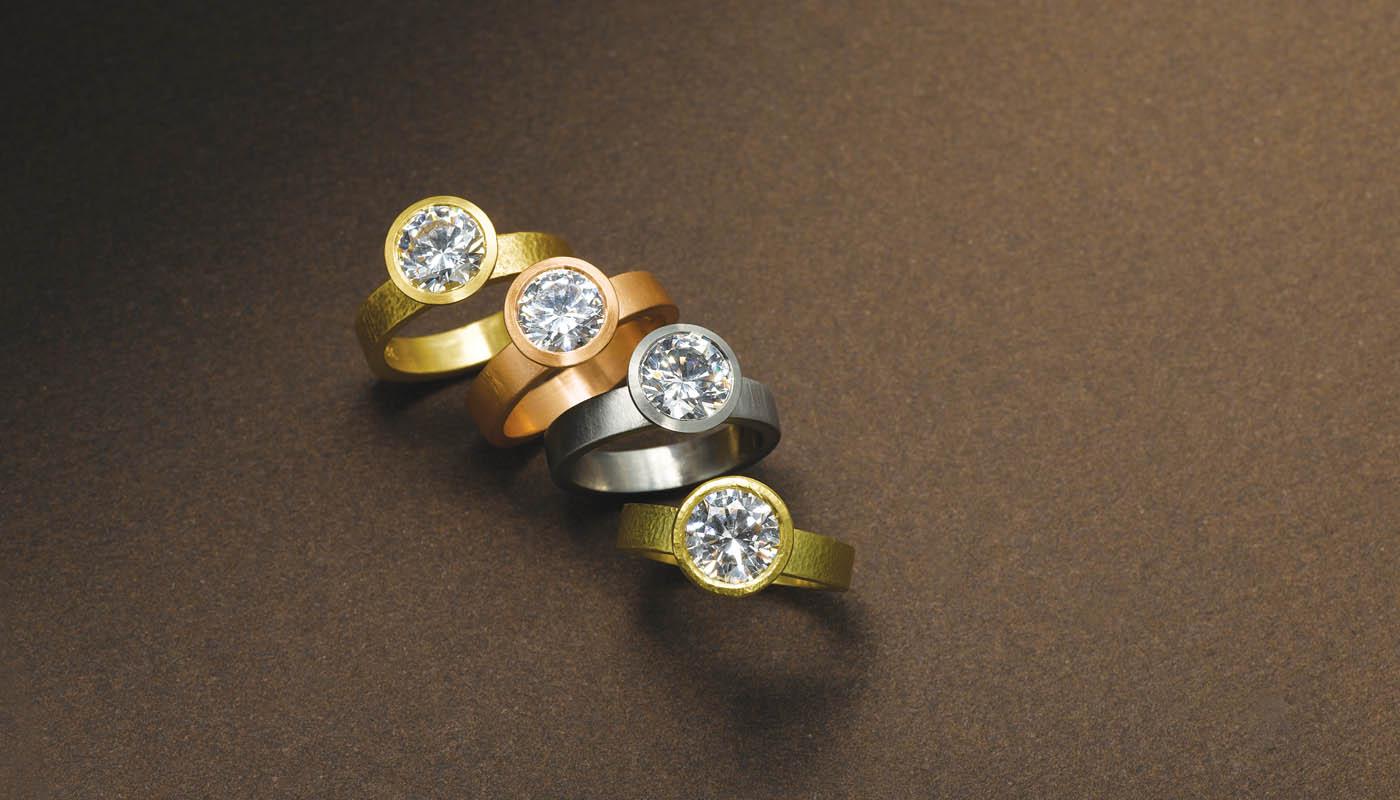 Diamond rings in 22 karat yellow, and 18 karat pink, white and green gold.