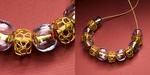 22 karat gold and handblown glass beads