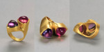 Amethyst and pink tourmaline cab trilliums set in 22 karat gold.