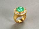 Hand hammered 22 karat gold. Paraiba tourmaline. Diamonds.