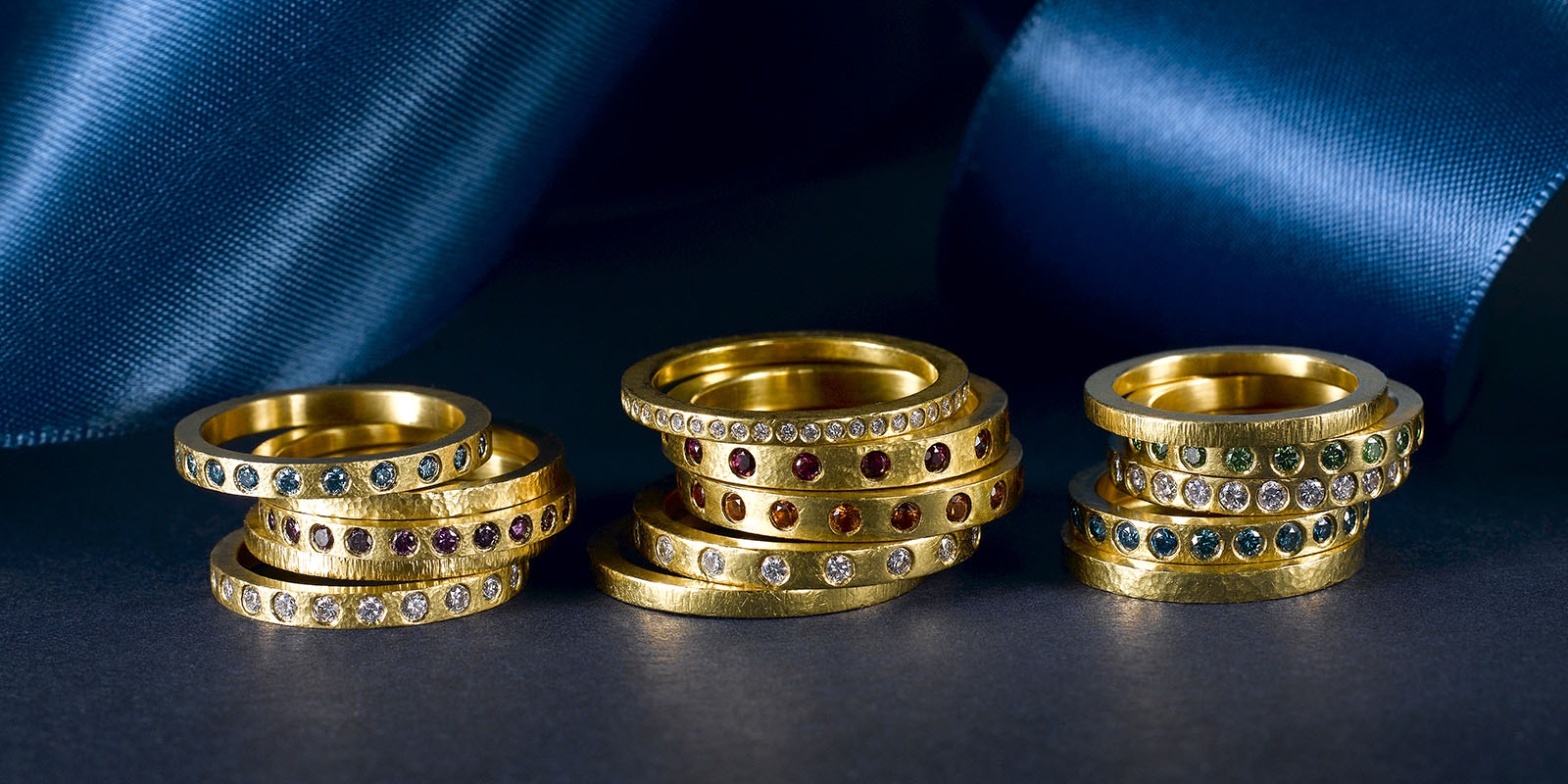 Stacking bands. 22 karat gold, white and color diamonds