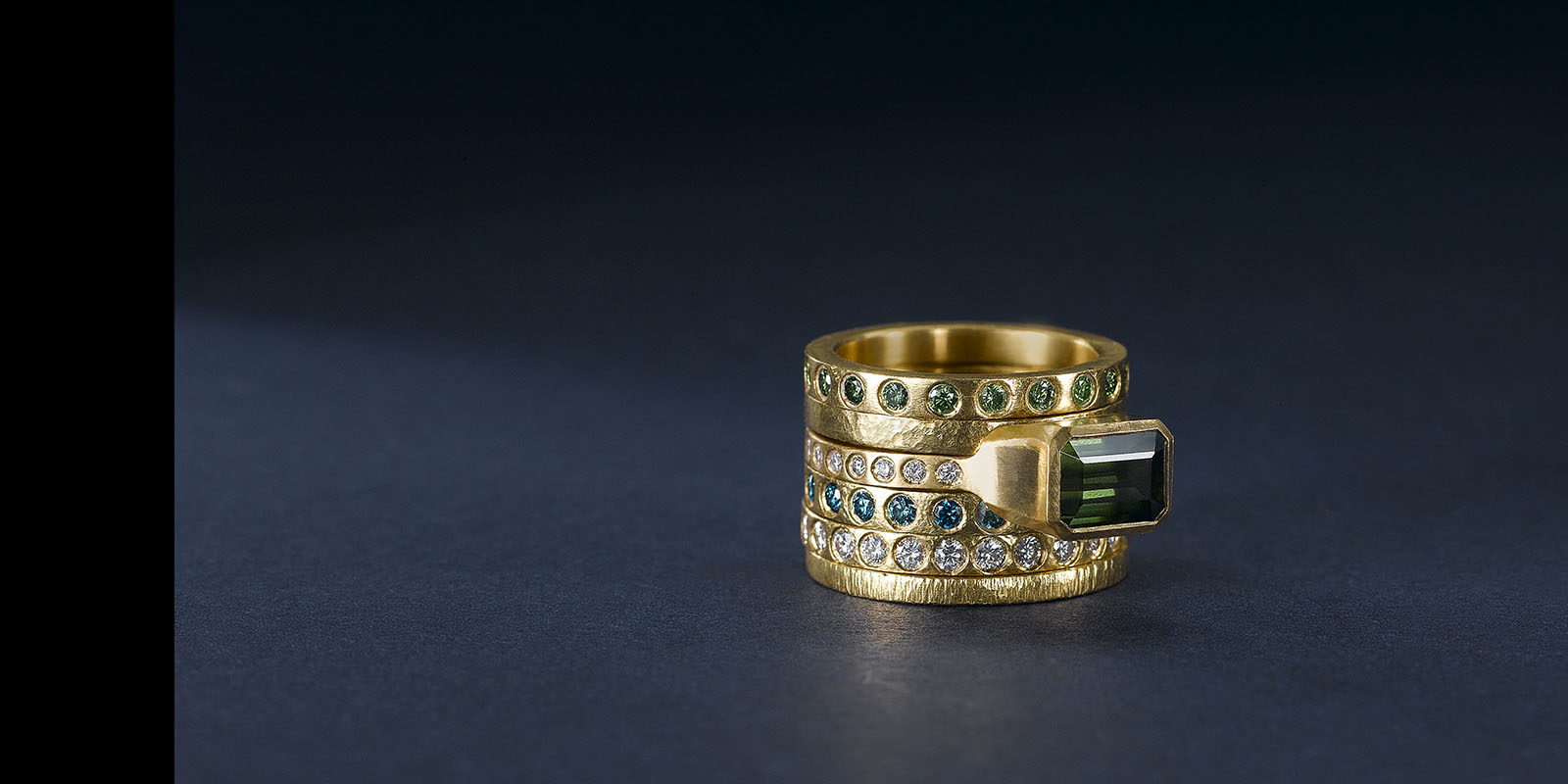 Stacking bands. 22 karat gold, color diamonds. Tourmaline solitaire.